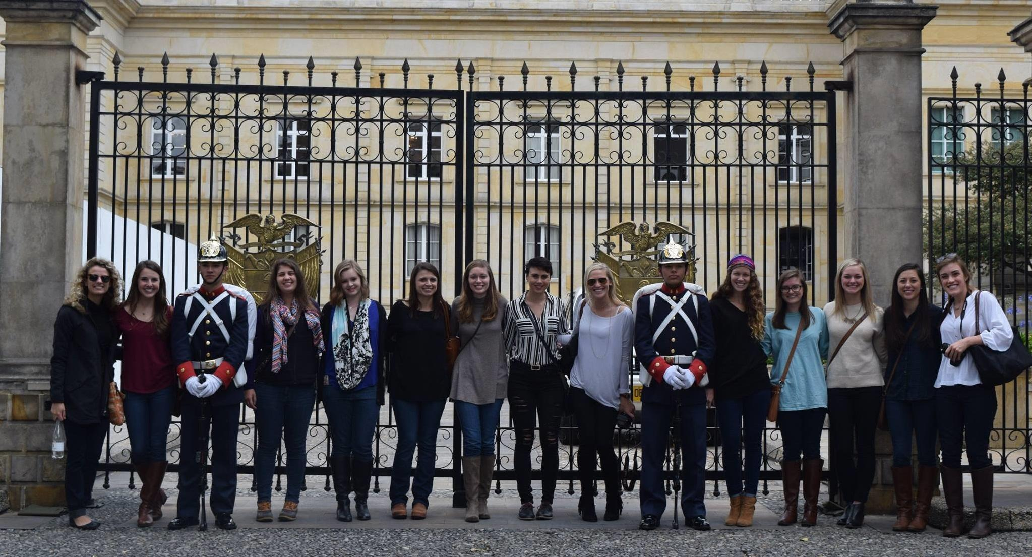 Students pose with city guards in Bogota